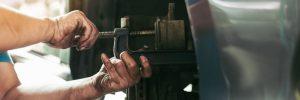 Mechanic Fixing Vehicle Axle